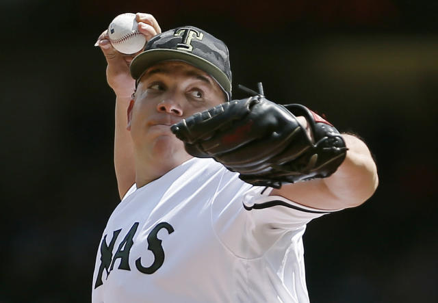 Texas Rangers starting pitcher Bartolo Colon (40) throws during the first inning of a baseball game against the Kansas City Royals, Saturday, May 26, 2018, in Arlington, Texas. (AP Photo/Brandon Wade)