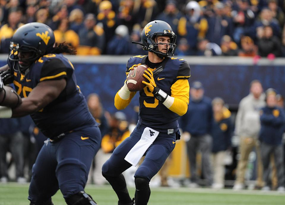 West Virginia's Clint Trickett (9) passes during the second quarter of an NCAA college football game against TCU in Morgantown, W.Va., Saturday, Nov. 1, 2014. (AP Photo/Tyler Evert)