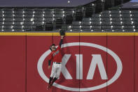 Cleveland Indians' Tyler Naquin leaps for but can't reach a two-run home run hit by New York Yankees' Gary Sanchez during the sixth inning of Game 2 of an American League wild-card baseball series, Wednesday, Sept. 30, 2020, in Cleveland. (AP Photo/David Dermer)