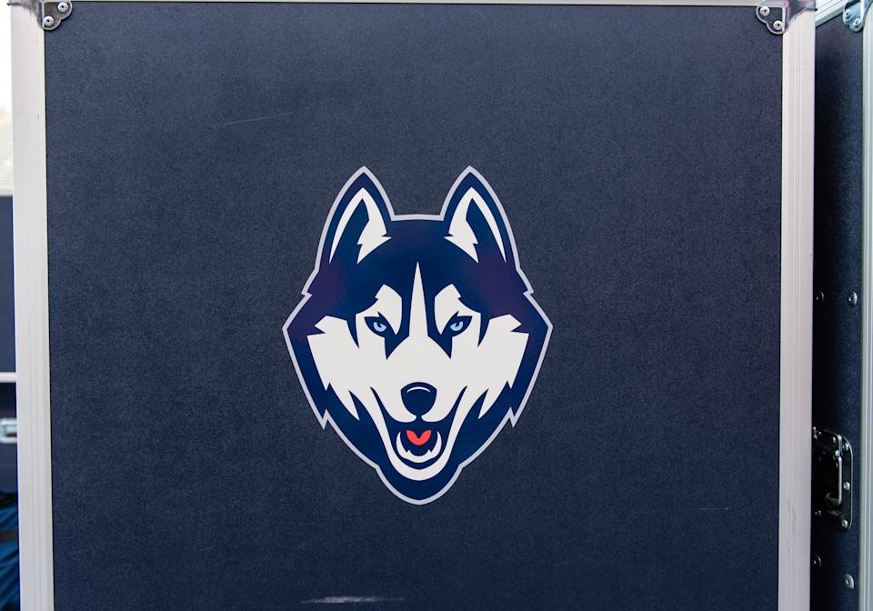 The Connecticut Huskies logo on an equipment box.