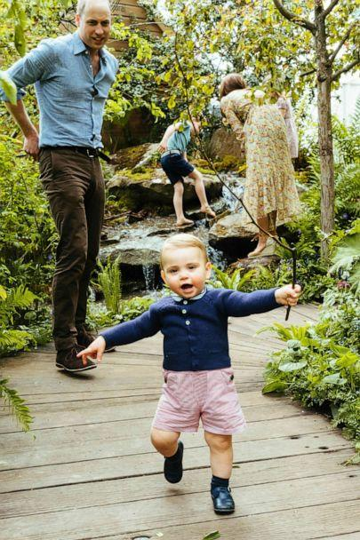 PHOTO: Prince William, Kate, Duchess of Cambridge and their children, Prince George, Princess Charlotte and Prince Louis play in the Adam White and Andree Davies co-designed garden ahead, in this image released on, May 19, 2019. (Matt Porteous/Kensington Palace via AP)