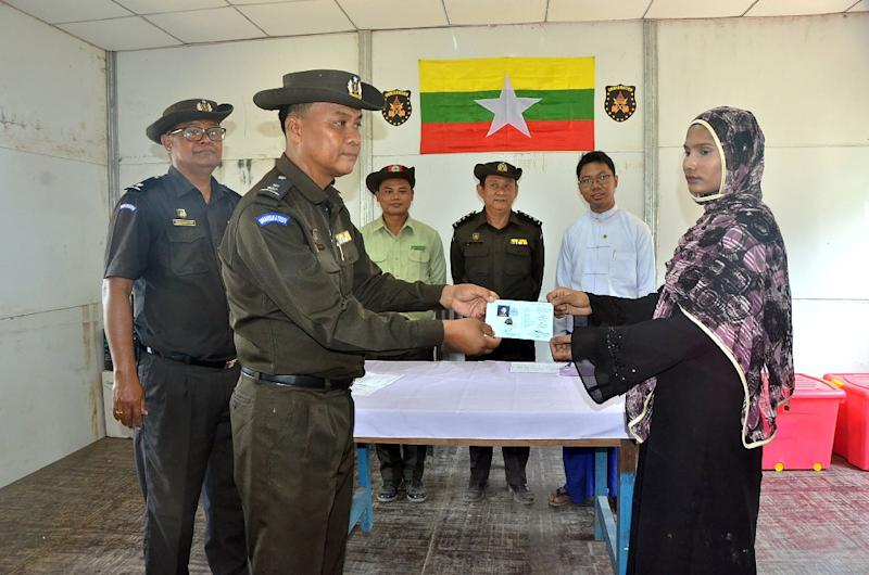 "A family of five was ""repatriated"" by Myanmar from a wedge of no-man's land between Myanmar and Bangladesh, but it was pilloried as a PR stunt by rights groups and labelled ""not meaningful"" by Bangladesh's home minister (AFP Photo/Myanmar News Agency)"