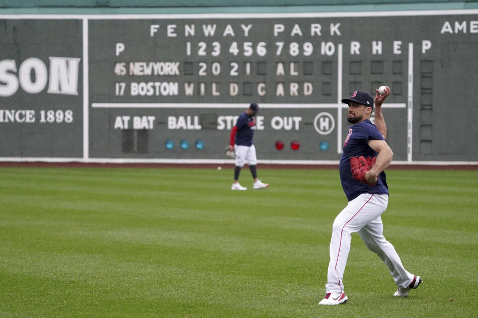 Boston Red Sox starting pitcher Nathan Eovaldi throws in the outfield at the American League Wild Card Workout Day at Fenway Park, Monday, Oct. 4, 2021, before Tuesday's American League Wild Card game against the New York Yankees in Boston. (AP Photo/Mary Schwalm)