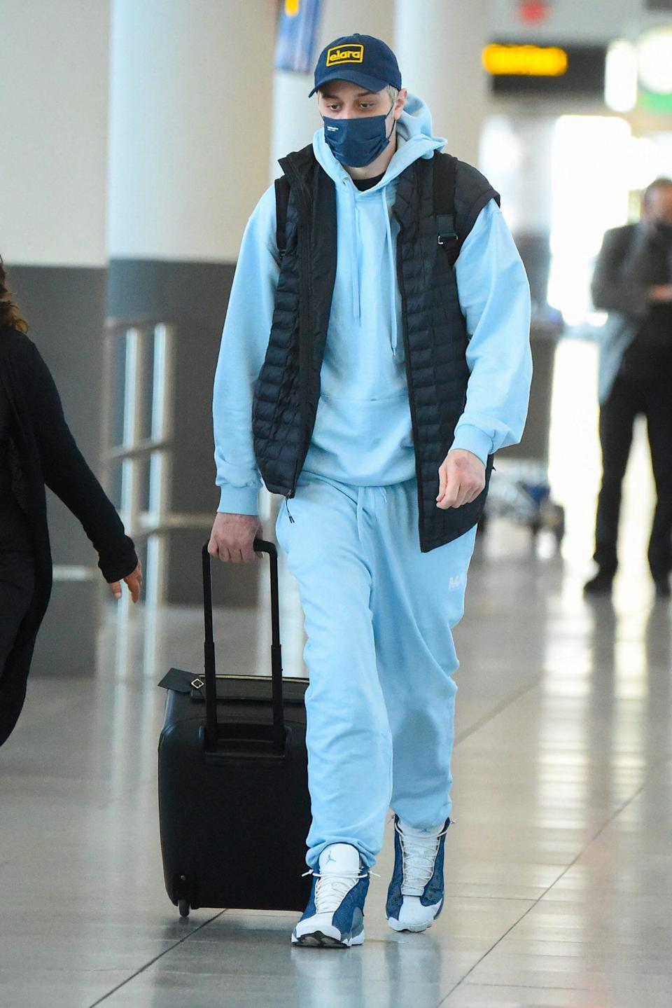 <p>Pete Davidson touches down at JFK Airport in New York City on Monday after heading to England to visit new flame Phoebe Dynevor.</p>