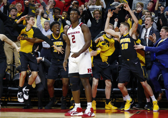 Iowa guard Joe Wieskamp (10) celebrates with teammates after hitting the winning basket in front of Rutgers center Shaquille Doorson (2) during the second half of an NCAA college basketball game Saturday, Feb. 16, 2019, in Piscataway, N.J. Iowa won 71-69. (AP Photo/Adam Hunger)