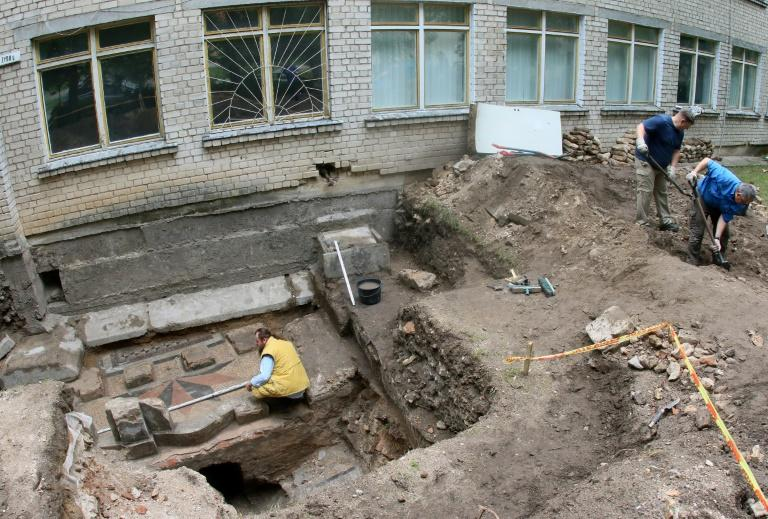 The stone plaque was discovered in a cellar below the most revered part of the Great Synagogue of Vilnius, Lithuania's major Jewish shrine before it was destroyed by Nazi and Soviet regimes
