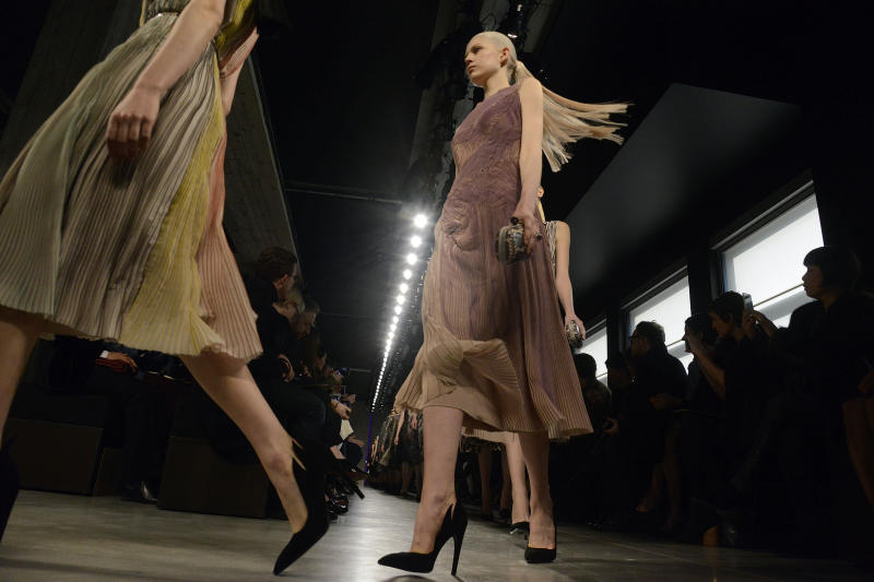A model wears a creation for Bottega Veneta women's Fall-Winter 2014-15 collection, part of the Milan Fashion Week, unveiled in Milan, Italy, Saturday, Feb.22, 2014. (AP Photo/Giuseppe Aresu)