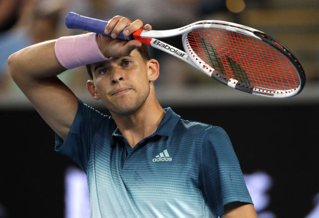 Austria's Dominic Thiem wipes the sweat from his face during his first round match against France's Benoit Paire at the Australian Open tennis championships in Melbourne, Australia, Tuesday, Jan. 15, 2019. (AP Photo/Mark Schiefelbein)