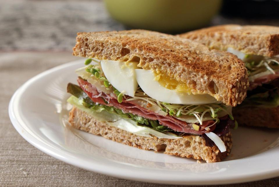 <p>This is ham and cheese, reinvented, with the addition of egg and sprouts. The hearty ingredients will keep for about as long as the protein-rich sandwich should tide you over. </p>
