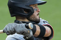 The Olympic rings are seen on the knob of Miami Marlins' Eddy Alvarez's bat as he swings at a pitch from the Baltimore Orioles during the seventh inning in the first game of a baseball doubleheader, Wednesday, Aug. 5, 2020, in Baltimore. Among the Marlins' roster replacements following their coronavirus outbreak was infielder Alvarez, a 2014 Olympic silver medalist in speedskating. And now at 30 he has made his major league debut. (AP Photo/Julio Cortez)