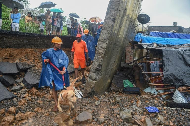 The death toll from a wall collapse in a Mumbai slum rose to 26 as the city braced for more rain