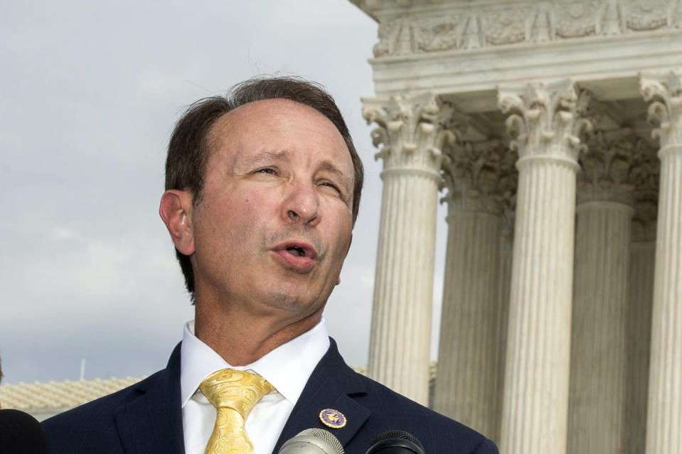 FILE - In this Sept. 9, 2019, file photo, Louisiana Attorney General Jeff Landry speaks in front of the U.S. Supreme Court in Washington. The Biden administration's suspension of new oil and gas leases on federal land and water was blocked Tuesday, June 15, 2021, by a federal judge in Louisiana. U.S. District Judge Terry Doughty's ruling came in a lawsuit filed in March by Louisiana's Republican attorney general, Jeff Landry and officials in 12 other states. Doughty's ruling granting a preliminary injunction to those states said his order applies nationwide. (AP Photo/Manuel Balce Ceneta, File)