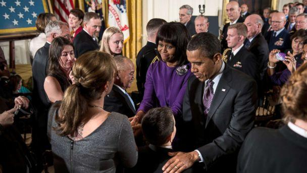 PHOTO: President Barack Obama and first lady Michelle Obama greet family members of fallen soldiers after a Medal of Honor ceremony in the East Room of the White House, Feb. 11, 2013. (Brendan Smialowski/AFP/Getty Images)