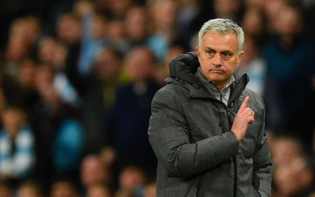 Mourinho gestures to referee Martin Atkinson after a decision goes against his teamCredit: AFP