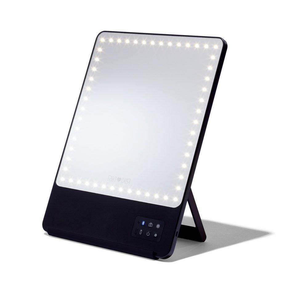 """With a magnetic phone clip and five different kinds of LED light dimming, this <a href=""""https://www.glamour.com/gallery/best-lighted-makeup-mirror?mbid=synd_yahoo_rss"""" rel=""""nofollow noopener"""" target=""""_blank"""" data-ylk=""""slk:lighted makeup mirror"""" class=""""link rapid-noclick-resp"""">lighted makeup mirror</a> is a makeup queen's dream. $205, Riki Loves Riki. <a href=""""https://www.violetgrey.com/product/riki-skinny/RIK-B-00100-BLK-US?nrtv_cid=6b7aeccef5175f2840def772718badb2f02433e3978f8994e0b56d8ddd12ee2c&utm_source=narrativ&utm_medium=display&utm_campaign=narrativ_premium_editorial&utm_content=glamour&utm_term=glamour&"""" rel=""""nofollow noopener"""" target=""""_blank"""" data-ylk=""""slk:Get it now!"""" class=""""link rapid-noclick-resp"""">Get it now!</a>"""