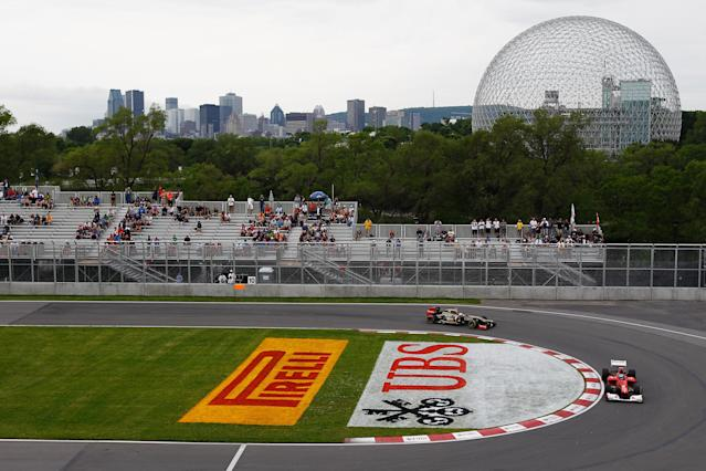 MONTREAL, CANADA - JUNE 08: Fernando Alonso of Spain and Ferrari drives ahead of Kimi Raikkonen of Finland and Lotus during practice for the Canadian Formula One Grand Prix at the Circuit Gilles Villeneuve on June 8, 2012 in Montreal, Canada. (Photo by Paul Gilham/Getty Images)