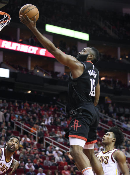 Houston Rockets guard James Harden (13) drives to the basket past Cleveland Cavaliers guard Collin Sexton, right, during the first half of an NBA basketball game Friday, Jan. 11, 2019, in Houston. (AP Photo/Eric Christian Smith)