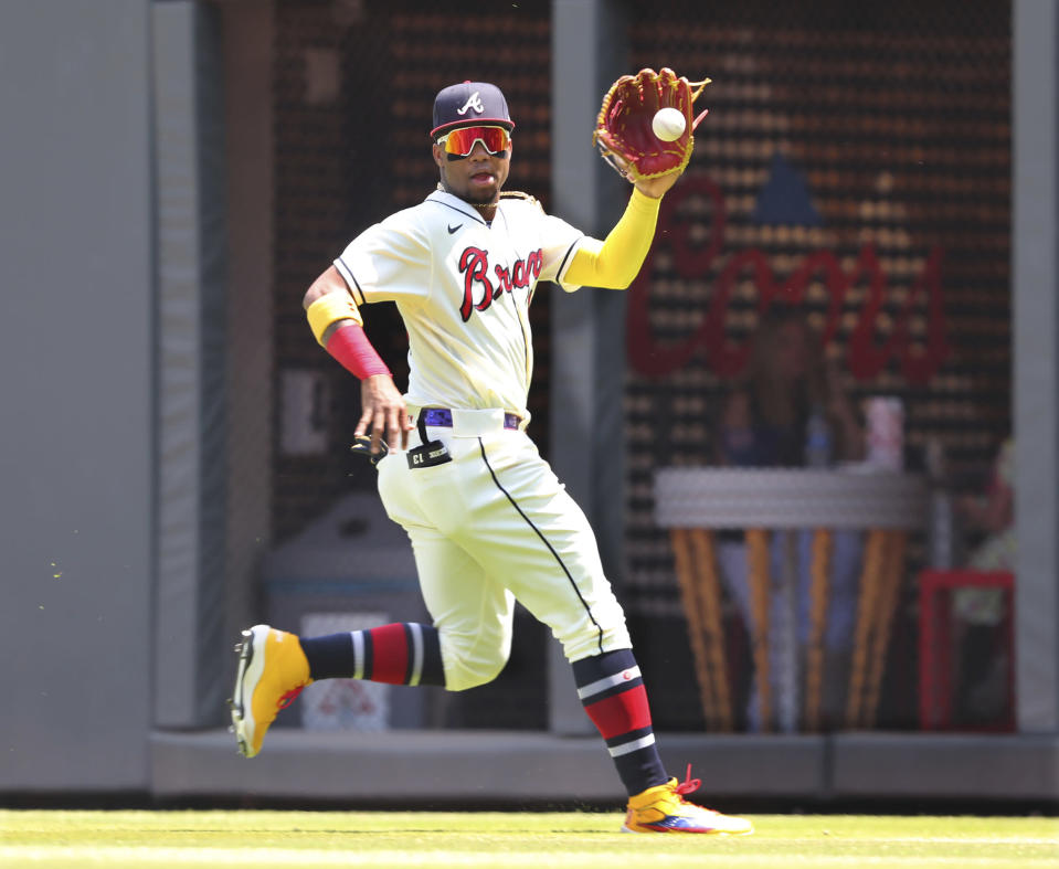 Atlanta Braves outfielder Ronald Acuna catches a fly ball by Pittsburgh Pirates during the ninth inning of a baseball game Sunday, May 23, 2021, in Atlanta. (Curtis Compton/Atlanta Journal-Constitution via AP)