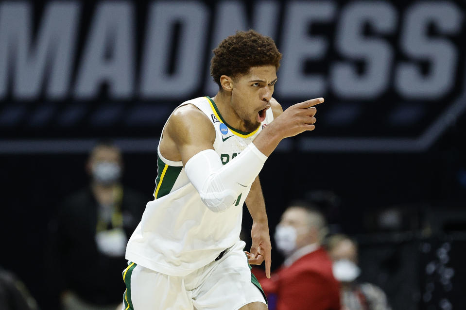 INDIANAPOLIS, INDIANA - MARCH 29: MaCio Teague #31 of the Baylor Bears reacts after making a three point basket against the Arkansas Razorbacks  during the second half in the Elite Eight round of the 2021 NCAA Men's Basketball Tournament at Lucas Oil Stadium on March 29, 2021 in Indianapolis, Indiana. (Photo by Tim Nwachukwu/Getty Images)