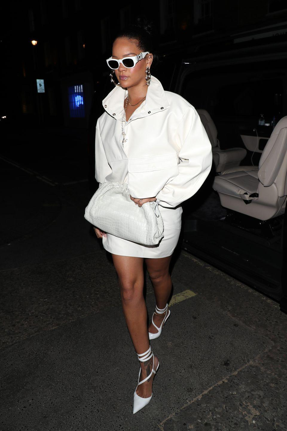 <p>In a white pullover by The Frankie Shop, leather skirt by Fenty, lace-up pumps, sunglasses, croc clutch, and oversized hoop earrings while arriving to a Fabergé event in London. </p>