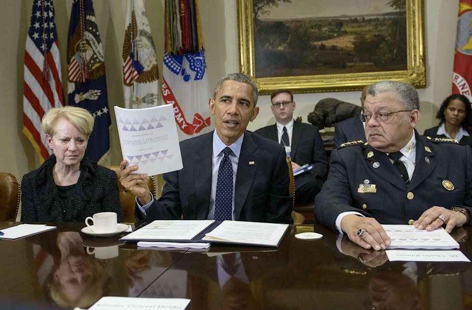 Laurie Robinson, left, professor of criminology at George Mason University, and Philadelphia Police Commissioner Charles H. Ramsey, right, listen while President Barack Obama talks about a report of law enforcement recommendations after a meeting in the Roosevelt Room of the White House March 2, 2015, in Washington, D.C. Obama met with members of his Task Force on 21st Century Policing to discuss their recommendations on how to strengthen community policing and trust among law enforcement officers and the communities they serve.