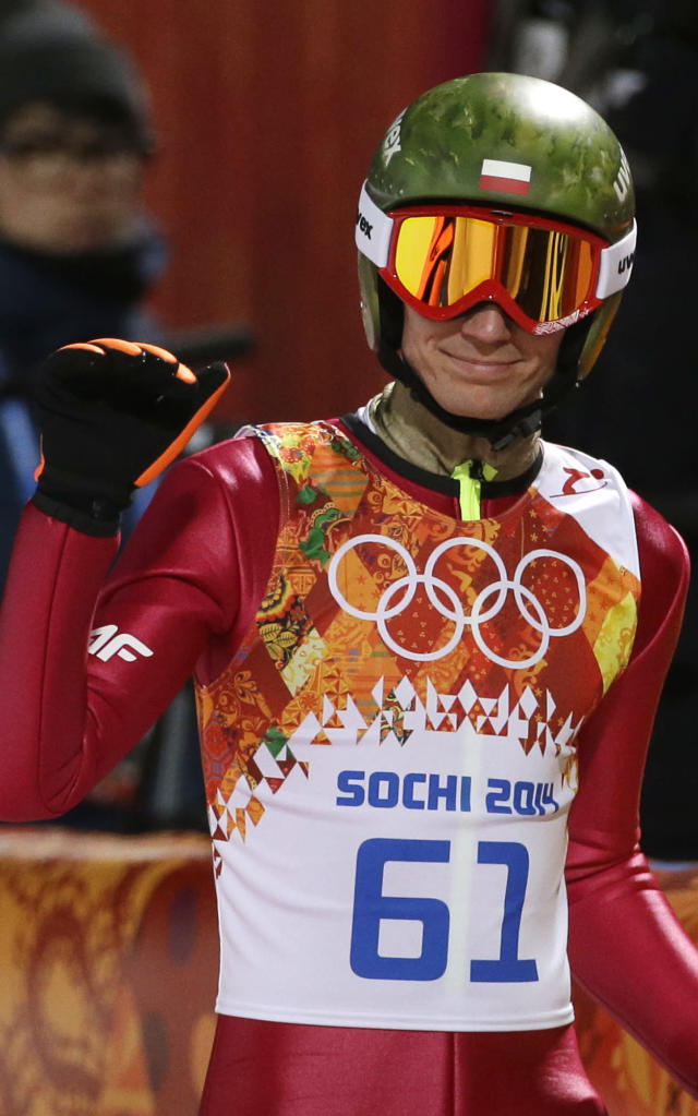 Poland's Kamil Stoch smiles after an attempt during the men's normal hill ski jumping qualification at the 2014 Winter Olympics, Saturday, Feb. 8, 2014, in Krasnaya Polyana, Russia. (AP Photo/Gregorio Borgia)