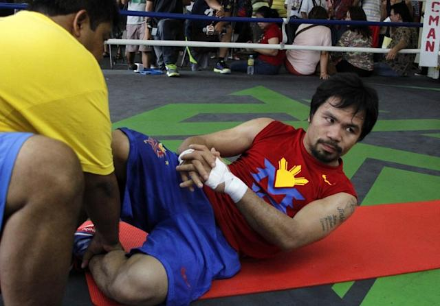 Philippine boxing icon Manny Pacquaio, seen in training in General Santos City on the island of Mindanao on February 23, 2015 (AFP Photo/)