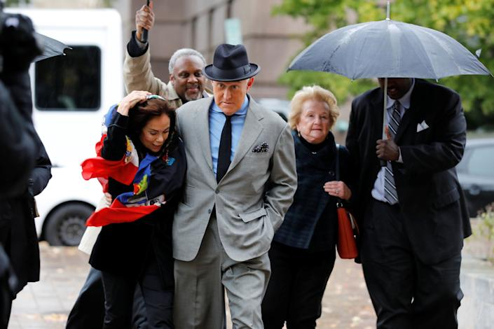 Roger Stone, former campaign adviser to Donald Trump, arrives with his wife, Nydia, at U.S. district court in Washington for the continuation of his criminal trial on charges of lying to Congress, obstructing justice and witness tampering. (Photo: Yuri Gripas / Reuters)