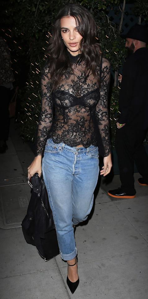 "<p>EmRata stunned while out to dinner in Beverly Hills in this casual-formal ensemble comprised of a sheer turtleneck top (try a similar top <a rel=""nofollow"" href=""http://click.linksynergy.com/fs-bin/click?id=93xLBvPhAeE&subid=0&offerid=255436.1&type=10&tmpid=10034&RD_PARM1=https%253A%252F%252Fwww.farfetch.com%252Fshopping%252Fwomen%252Flanvin-floral-lace-turtle-neck-item-11590683.aspx%253Ffsb%253D1%2526storeid%253D9851%2526size%253D20%2526gclid%253DCj0KEQiA0L_FBRDMmaCTw5nxm-ABEiQABn-Vqcr6h2v0mjhPLNNB3JwQ1HlP5u-EtvI3A-ka5lYpty0aAtsx8P8HAQ%2526dclid%253DCIKR8earqdICFcUFNwodhX4NRw&u1=ISEmRataSheerTopIJFeb"">here</a>), Levi's boyfriend jeans (shop a similar style <a rel=""nofollow"" href=""http://click.linksynergy.com/fs-bin/click?id=93xLBvPhAeE&subid=0&offerid=460311.1&type=10&tmpid=21552&RD_PARM1=https%3A%2F%2Fwww.shopspring.com%2Fproducts%2F52939308&u1=ISEmRataLevisIJFeb"">here</a>), and ankle-strap pointed-toe pumps. </p>"