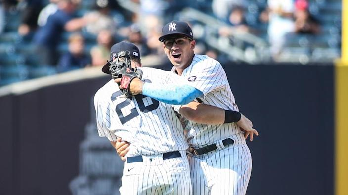 Gleyber Torres hugs DJ LeMahieu after turning triple play to end game