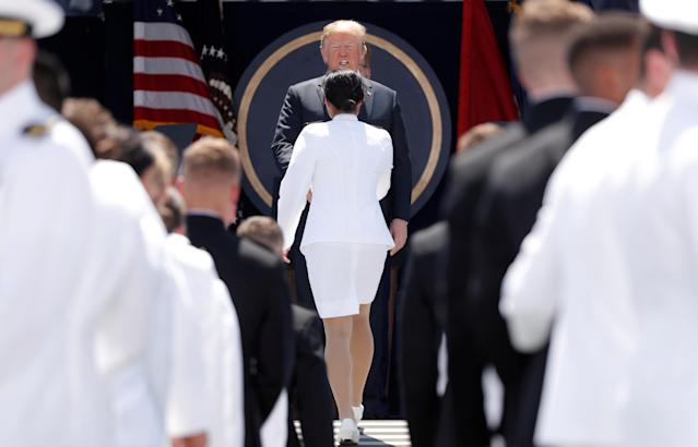 <p>President Donald Trump congratulates a female graduate at the commissioning and graduation ceremony for U.S. Naval Academy Class of 2018 at the Navy-Marine Corps Memorial Stadium in Annapolis, Md., May 25, 2018. (Photo: Kevin Lamarque/Reuters) </p>