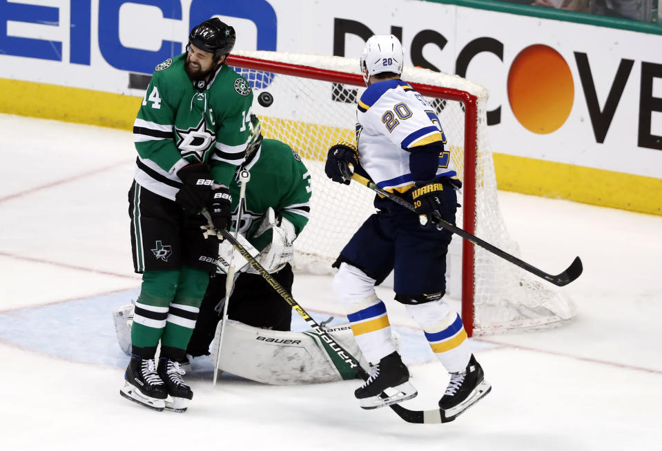 CORRECTS THAT THE SHOT WAS BY COLTON PARAYKO, NOT JADEN SCHWARTZ. - St. Louis Blues' Alexander Steen (20) watches as a shot by teammate Colton Parayko, not shown, slips past Dallas Stars' Jamie Benn (14) and hits Stars goaltender Ben Bishop during the third period in Game 6 of an NHL second-round hockey playoff series, Sunday, May 5, 2019, in Dallas. Bishop was injured on the play leading to a goal by the Blues' Jaden Schwartz. (AP Photo/Tony Gutierrez)