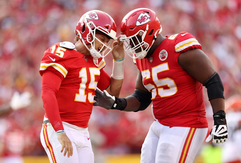 Patrick Mahomes of the Kansas City Chiefs celebrates with Trey Smith #65 after throwing a touchdown pass during the fourth quarter at Arrowhead Stadium on September 12, 2021 in Kansas City, Missouri.
