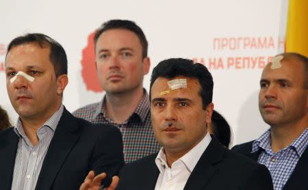 Macedonian Social Democratic leader Zaev and members of his party attend a news conference in Skopje