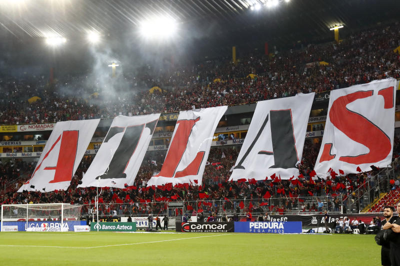 GUADALAJARA, MEXICO - MARCH 07: Fans of Atlas show giant letters to spell Atlas during the 9th round match between Atlas and Chivas as part of the Torneo Clausura 2020 Liga MX at Jalisco Stadium on March 7, 2020 in Guadalajara, Mexico. (Photo by Refugio Ruiz/Getty Images)