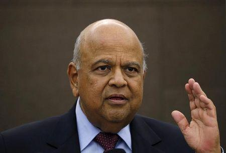 South African Finance Minister Pravin Gordhan reacts during a media briefing in Sandton near Johannesburg
