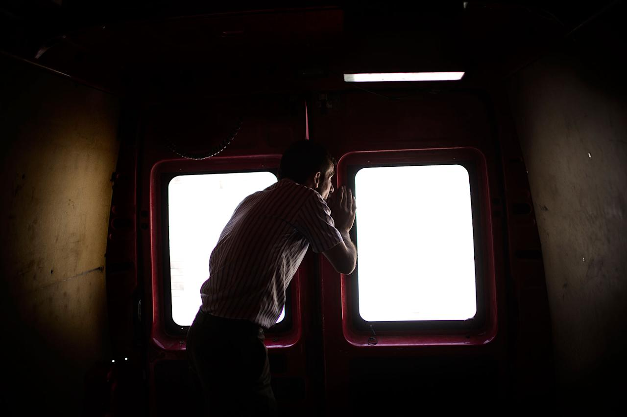 <p>Mohammed looks through the window of a civil defense rescue team vehicle while on his way to find his relatives killed after an airstrike in Mosul. West Mosul. Iraq. July 2, 2017. (Photograph by Diego Ibarra Sánchez / MeMo) </p>
