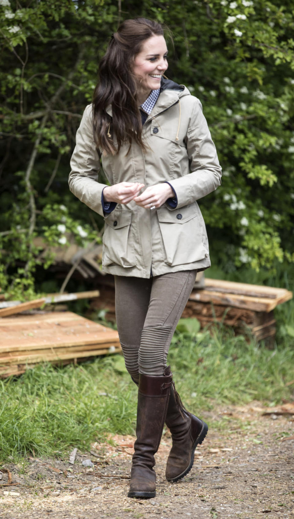 <p>The Duchess dressed down to visit a city farm in Gloucestershire. Wearing a £350 wax parka by Troy London, Kate donned brown biker jeans from Zara, a navy J Crew sweater and gingham shirt from Gap. She finished the neutral ensemble with tasselled Penelope Chilvers boots that she has been wearing for a whopping 13 years. </p><p><i>[Photo: PA]</i></p>