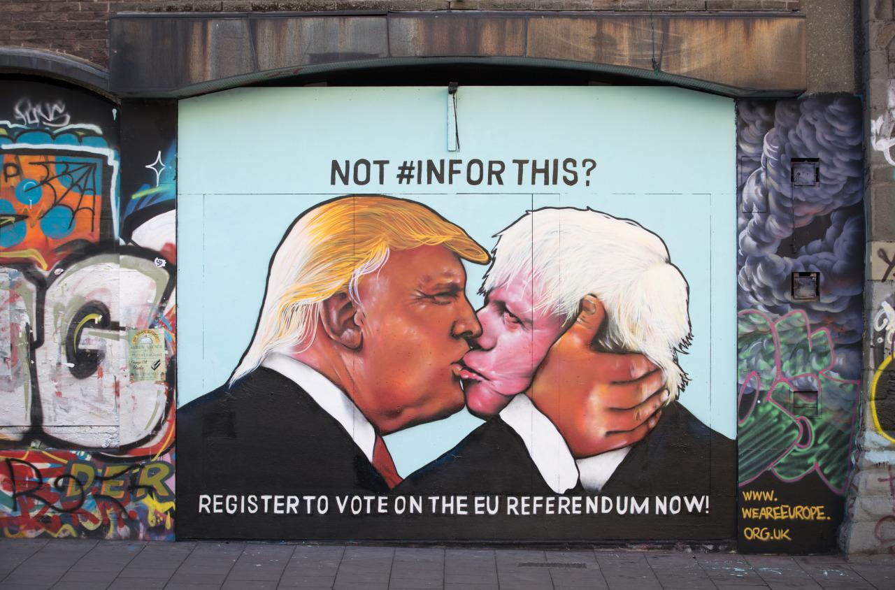 <p>A mural that has been painted on a derelict building in Stokes Croft shows U.S. presidential hopeful Donald Trump sharing a kiss with former London Mayor Boris Johnson. (Matt Cardy/Getty Images)</p>