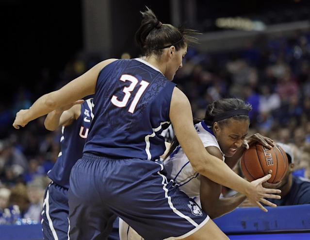 Connecticut center Stefanie Dolson (31) blocks the path of Memphis guard Devin Mack, right, in the first half of an NCAA college basketball game Saturday, Jan. 4, 2014, in Memphis, Tenn. (AP Photo/Mark Humphrey)