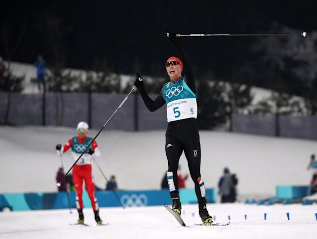 Nordic Combined Events - Pyeongchang 2018 Winter Olympics – Men's Individual 10km Final – Alpensia Cross-Country Skiing Centre - Pyeongchang, South Korea – February 14, 2018. Eric Frenzel of Germany reacts as he approaches the finish line ahead of Akito Watabe of Japan. REUTERS/Carlos Barria