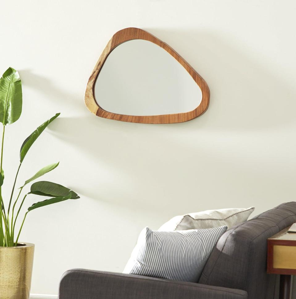 <p>This <span>Musso Wood Accent Mirror</span> ($365, originally $431) will add some texture to your space.</p>