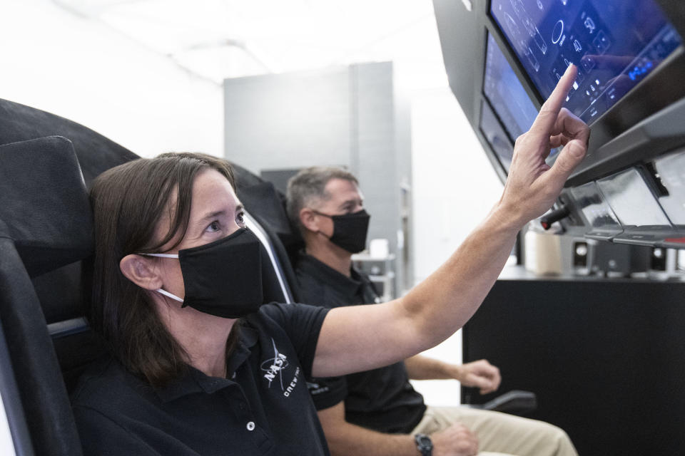 NASA astronauts Megan McArthur and Shane Kimbrough can be seen in this image, which McArthur shared to Twitter, at SpaceX, practicing how to fly the company's Crew Dragon vehicle. The pair will make up half of the crew that will fly to the space station with SpaceX's Crew-2 mission, slated for 2021.