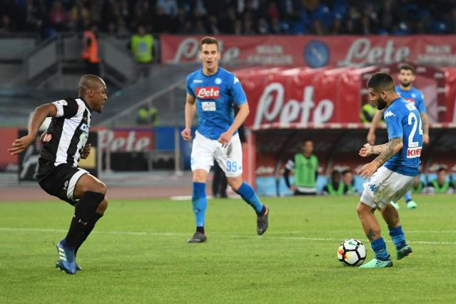Napoli's Lorenzo Insigne, right, scores the Serie A soccer match between Napoli and Udinese at the San Paolo Stadium in Naples, Italy, Wednesday, April 18, 2018. (Ciro Fusco/ANSA via AP)