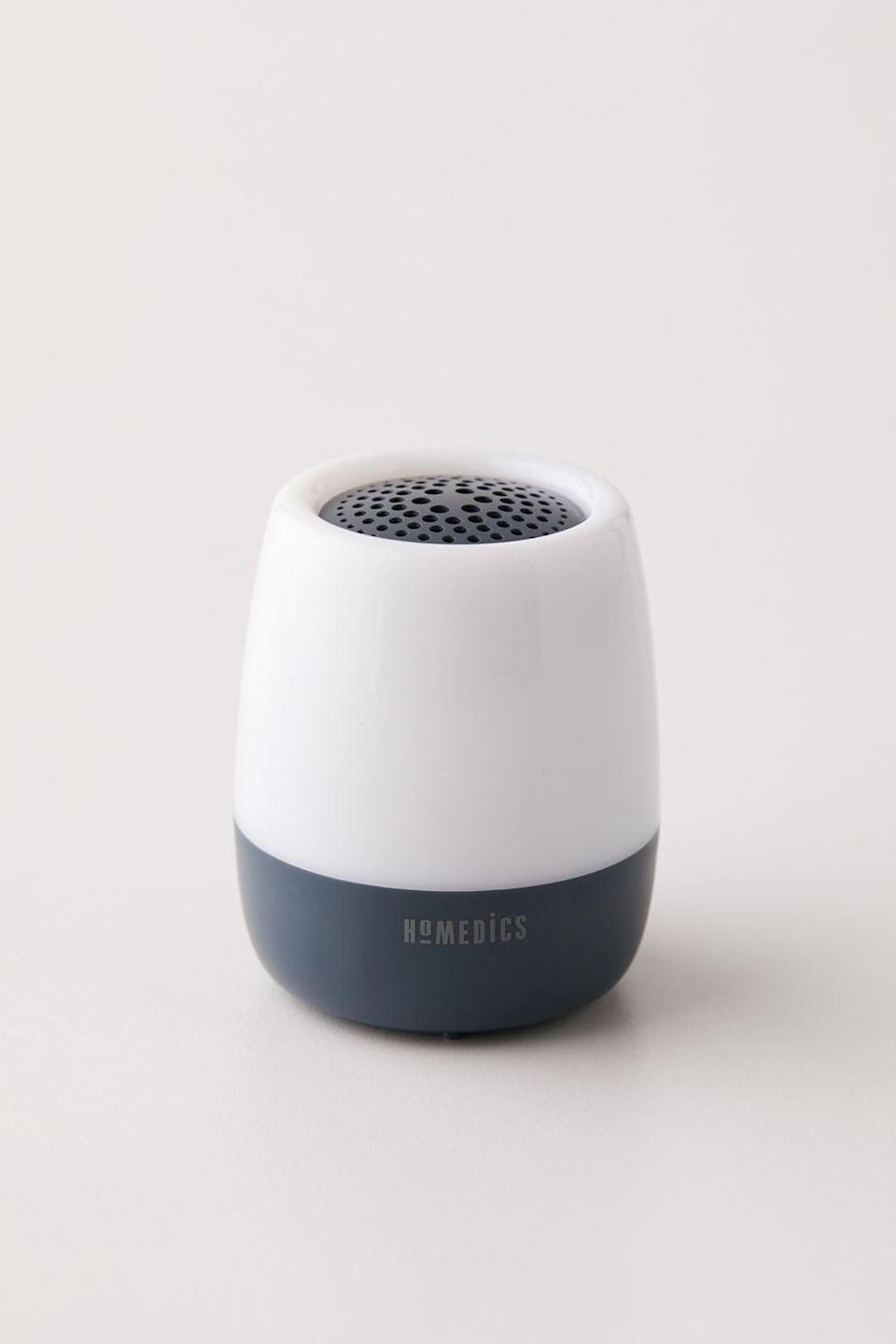 <p>If they have a hard time sleeping in unfamiliar Airbnb's or hotel rooms, this <span>HoMedics SoundSpa Traveler Portable Sound Machine</span> ($25) will put them at ease. It has six sounds including brook, ocean, white noise, flute, ASMR tapping and thunderstorm with an auto-off timer. It's rechargable and doubles as a nightlight as well!</p>