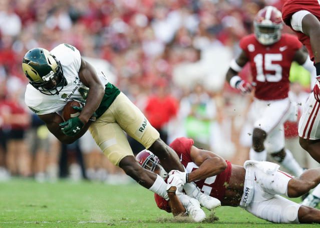 FILE - In this Sept. 16, 2017, file photo, Alabama defensive back Minkah Fitzpatrick tackles Colorado State wide receiver Michael Gallup during the first half of an NCAA college football game in Tuscaloosa, Ala. Fitzpatrick is a possible first round pick in the NFL Draft. (AP Photo/Brynn Anderson, File)