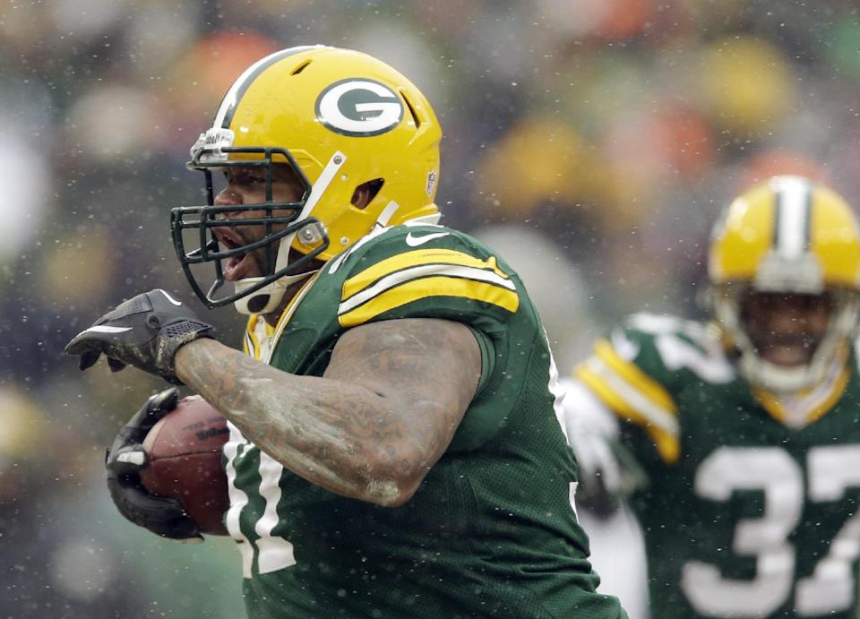 Green Bay Packers' Johnny Jolly reacts after recovering a fumble during the second half of an NFL football game against the Atlanta Falcons Sunday, Dec. 8, 2013, in Green Bay, Wis. (AP Photo/Tom Lynn)