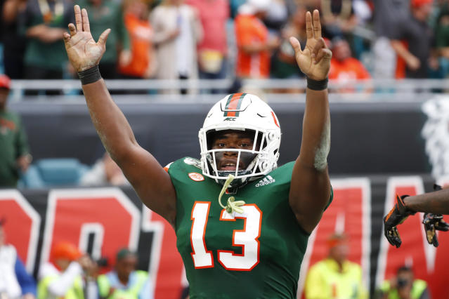 Miami running back DeeJay Dallas celebrates a touch down during the first half of an NCAA college football game against Louisville, Saturday, Nov. 9, 2019, in Miami Gardens, Fla. (AP Photo/Wilfredo Lee)