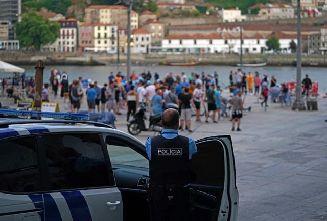 Police watch over Manchester City fans in Porto ahead of the UEFA Champions League final in Porto