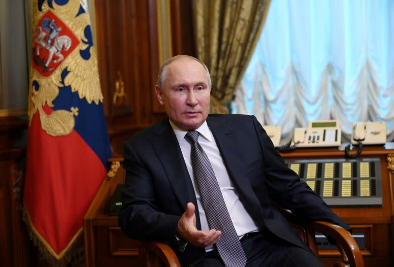 """FILE PHOTO: Russian President Putin answers questions about his article """"On the historical unity of Russians and Ukrainians"""" in Saint Petersburg"""